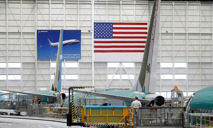 FILE PHOTO: Employees work on 737 Max aircraft, seen at the Boeing factory in Renton