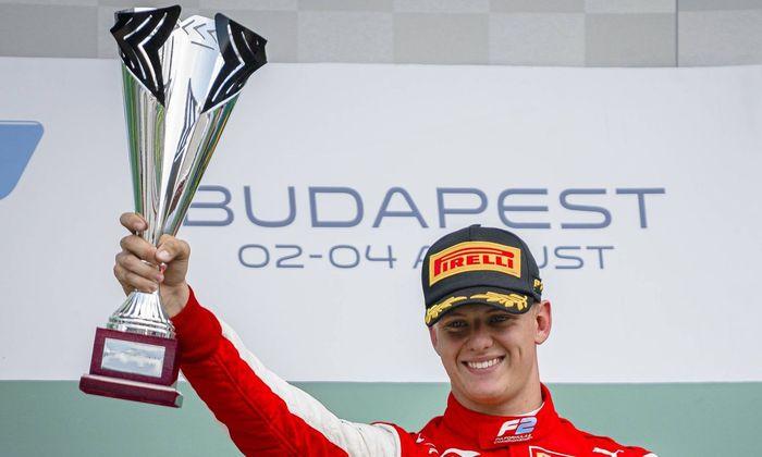 August 4, 2019, Budapest, Hungary: Prema Racing'!s German racing driver Mick Schumacher celebrates on podium after winni