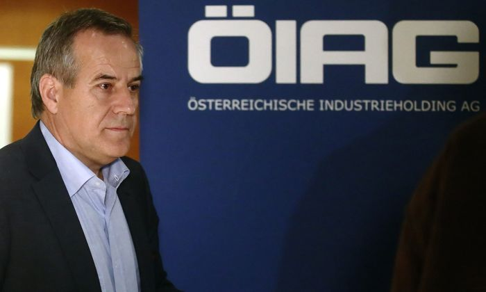 Siegfried Wolf, chairman of Austrian state holding OIAG, leaves a news conference in Vienna