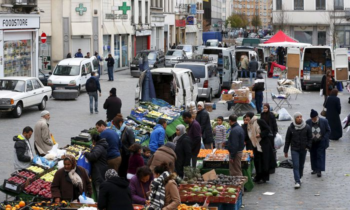 People shop at a market in the neighbourhood of Molenbeek in Brussels, Belgium