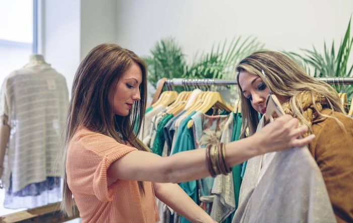 Two women shopping for clothes in a boutique model released Symbolfoto property released PUBLICATION