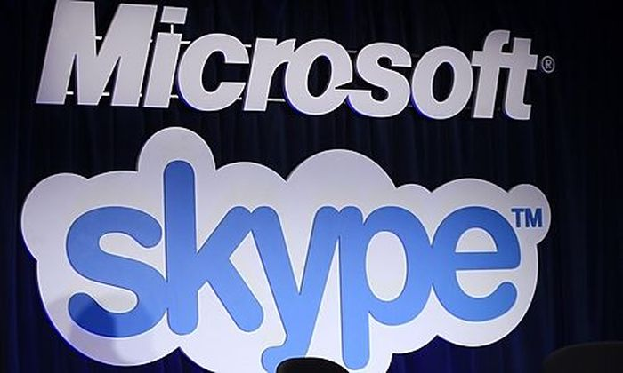 A Microsoft and Skype sign are displayed at a news conference in San Francisco Tuesday, May 10, 2011,