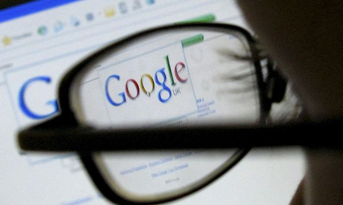 A Google search page is seen through the spectacles of a computer user in Leicester
