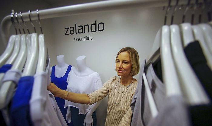 File photo of an employee posing in a showroom of the fashion retailer Zalando in Berlin