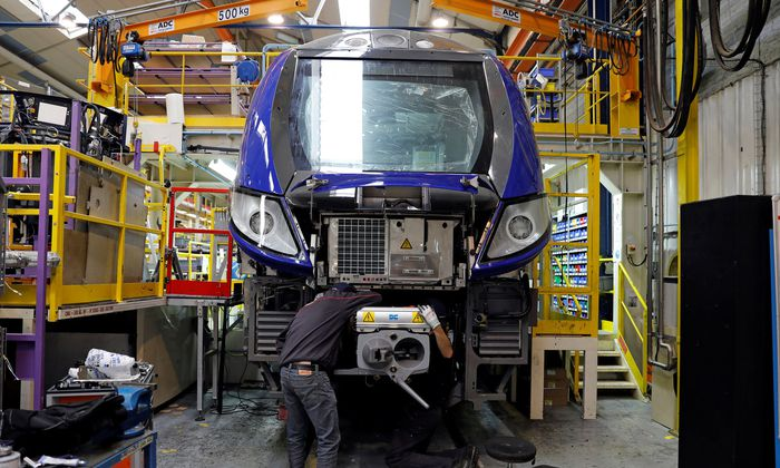 An employee works on a new regional transport train at the Bombardier plant in Crespin, near Valenciennes