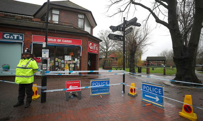A police officer guards a cordoned off area in the city centre where former Russian intelligence officer Sergei Skripal and his daughter Yulia were found poisoned, in Salisbury