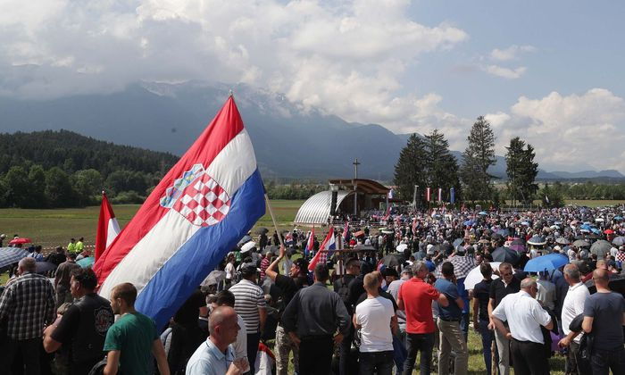 Participants take part in a Catholic ceremony commemorating the turning away from Austria of pro-Nazi Croatians at the end of World War Two in Bleiburg