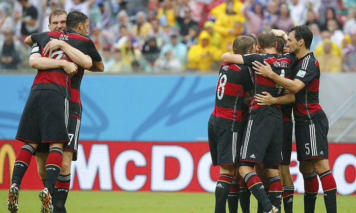 Germany´s players celebrate their first goal against the U.S. during their 2014 World Cup Group G soccer match at the Pernambuco arena in Recife