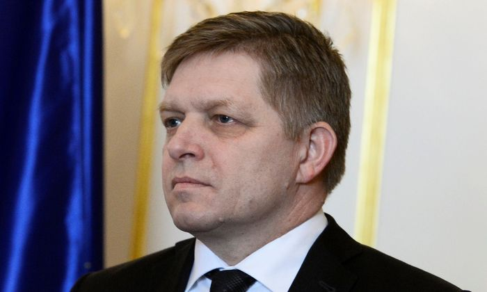 Slovakia's Prime Minister Robert Fico reacts after a meeting of SlovakiaâAeOes three top officials at the Bratislava castle