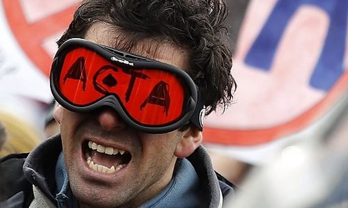 Protestor shouts slogans during a demonstration against ACTA in central Sofia