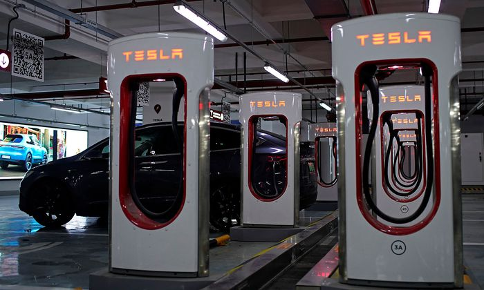 Tesla Superchargers are pictured in a parking lot in Suzhou