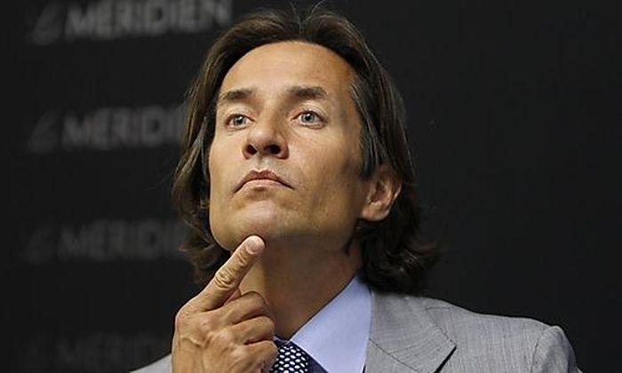 Former Austrian Finance Minister Grasser gestures during news conference in Vienna