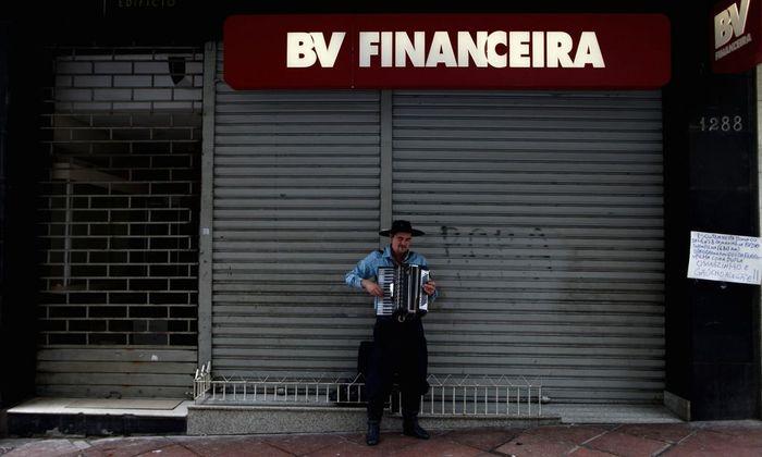 A gaucho plays the accordion in downtown Porto Alegre