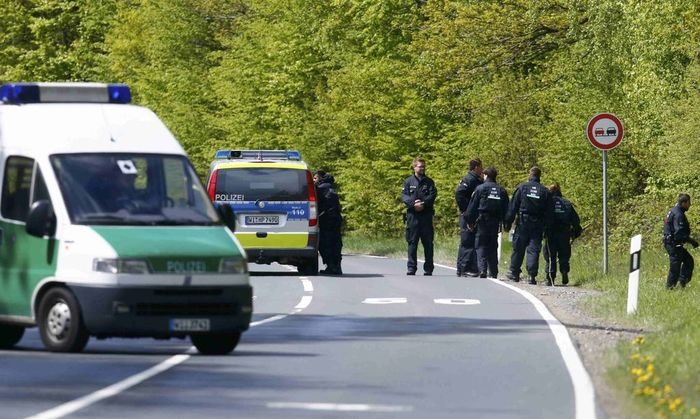 Police conduct a search of a forest area just outside the town of Oberursel near Frankfurt,