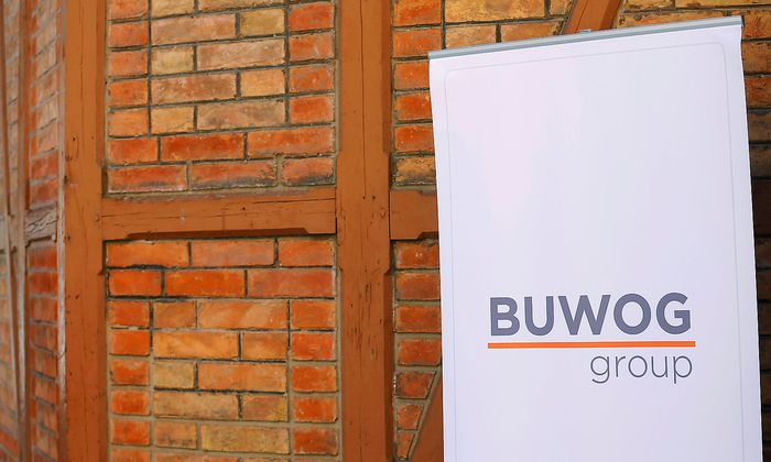 A banner with the logo of property group Buwog is seen next to the entrance to a news conference in Vienna