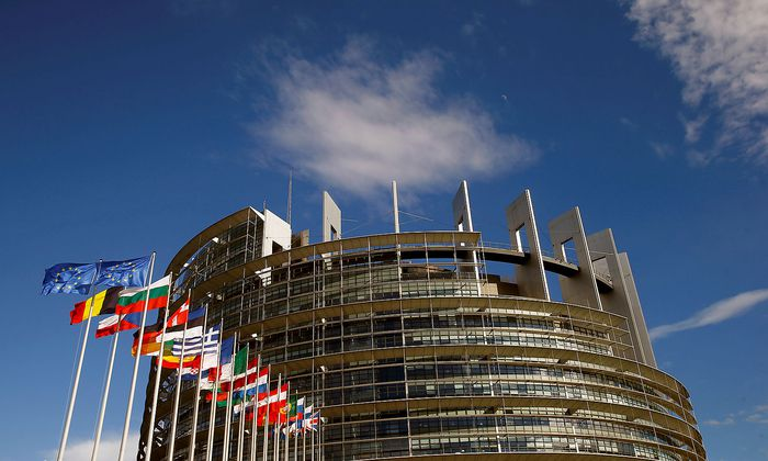 FILE PHOTO: Flags of the European Union and its member states fly in front of the building of the European Parliament in Strasbourg