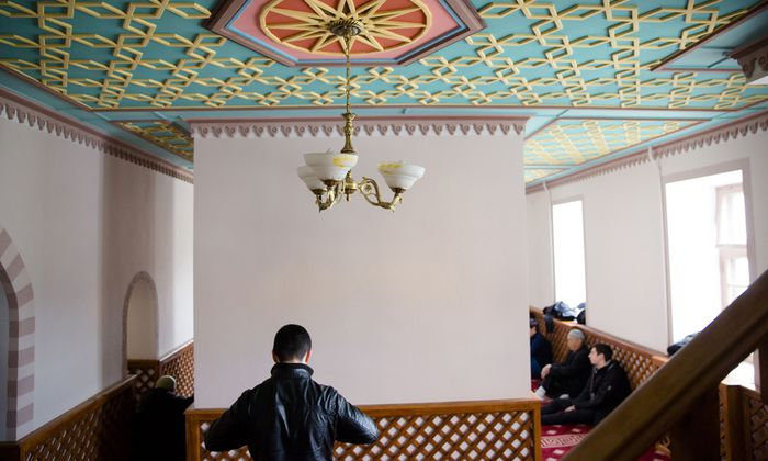 Muslim Tatar man prays in Kebir-Dzhami mosque in old town of Simferopol