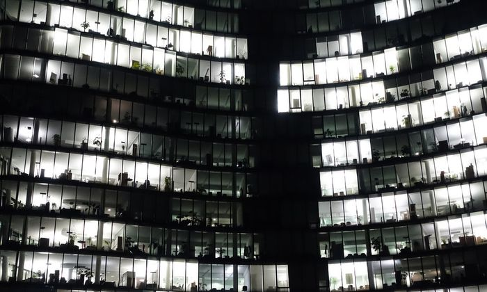 Austria, Vienna, lighted windows of an office building by night