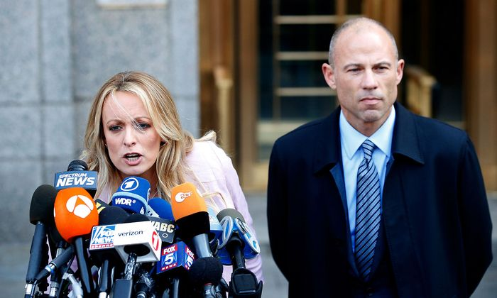 FILE PHOTO: Adult film actress Stephanie Clifford, also known as Stormy Daniels, speaks to media along with lawyer Michael Avenatti outside federal court in Manhattan