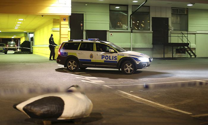 Police officer stands at the scene of a fatal shooting in Gothenburg,