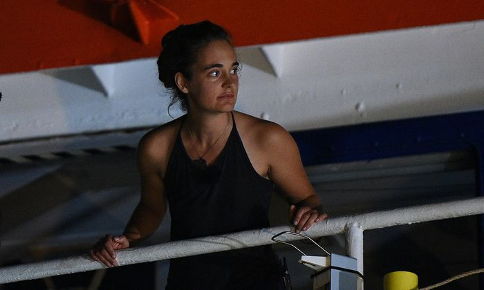Carola Rackete, the 31-year-old Sea-Watch 3 captain, is seen onboard the ship as it docks in Lampedusa