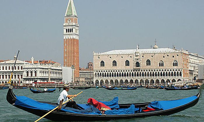 Gondolas engage the waters in front of Venice's St. Mark's Square, northern Italy, Friday, July 23, 2