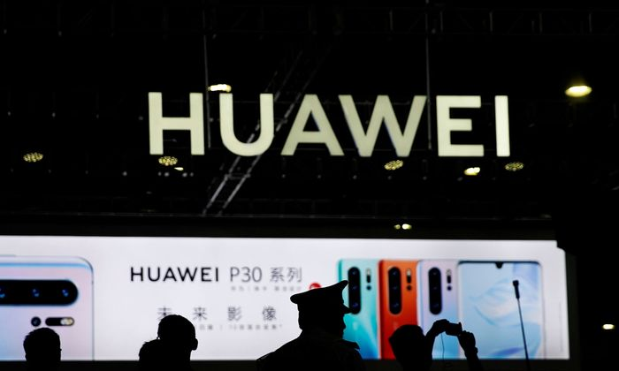 A Huawei logo is seen at CES Asia 2019 in Shanghai