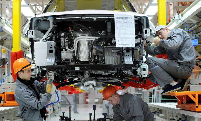 MINSK REGION BELARUS NOVEMBER 23 2017 Assembling Geely Atlas NL3 cars at a new BelGee plant nea