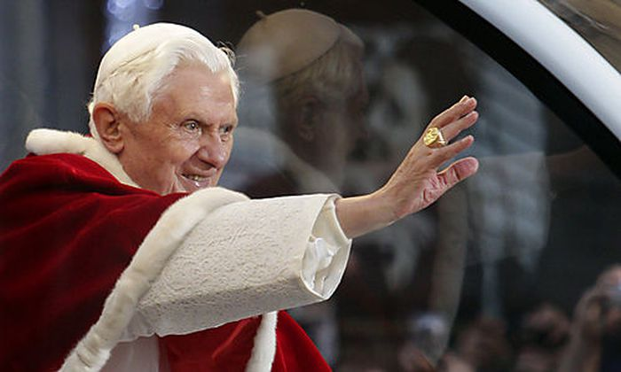 Pope Benedict XVI waves to faithful from his popemobile, in Rome, Wednesday Dec. 8, 2010. Pope Benedi