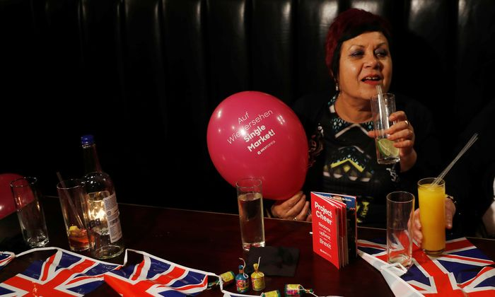 A woman holds a Pro-Brexit balloon in a pub at an event to celebrate the invoking of Article 50 after Britain´s Prime Minister Theresa May triggered the process by which the United Kingdom will leave the European Union, in London