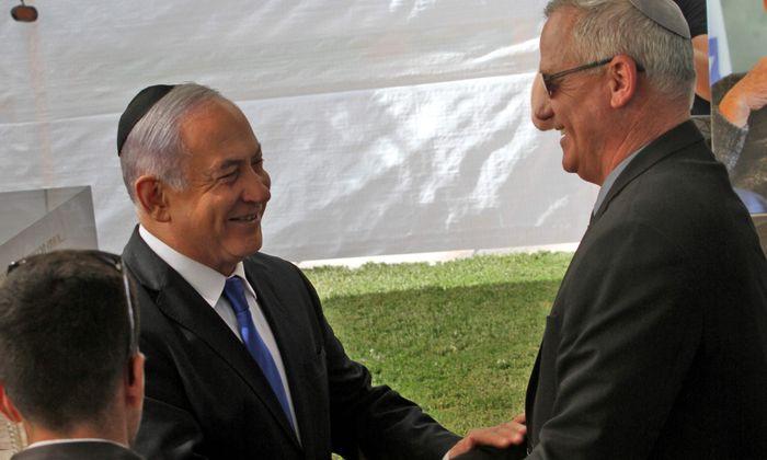 Gegenspieler Benjamin Netanjahu und Benny Gantz beim Gedenkakt für Schimon Peres.