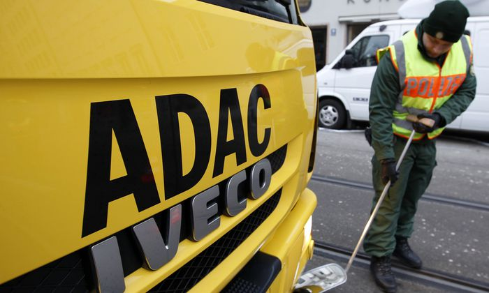 German police officer checks ADAC car before start of 50th Conference on Security Policy in Munich