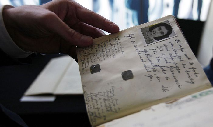 Dutch Minister of Education Ronald Plasterk looks at a facsimile of Anne Frank´s dairy after a news conference in Amsterdam