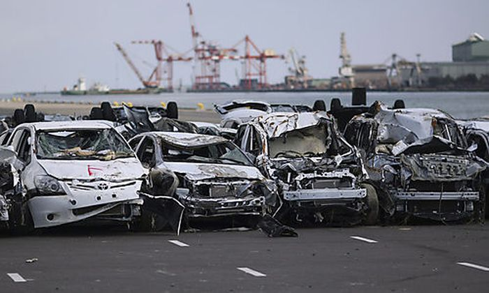 FILE - In this March 28, 2011 file photo, new vehicles damaged by the March 11 tsunami waters sit lin