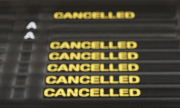 An information board shows all flights cancelled at the Zaventem international airport near Brussels