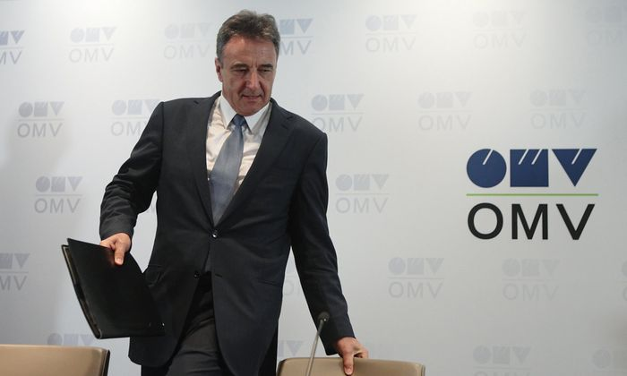 Roiss, chief executive of Austrian oil and gas group OMV, arrives for a news conference in Vienna