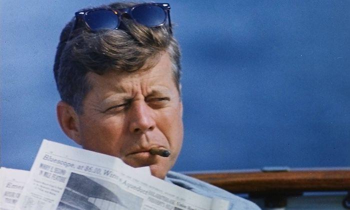 Hyannisport Weekend President John F Kennedy with cigar and New York Times Hyannisport MA aboar