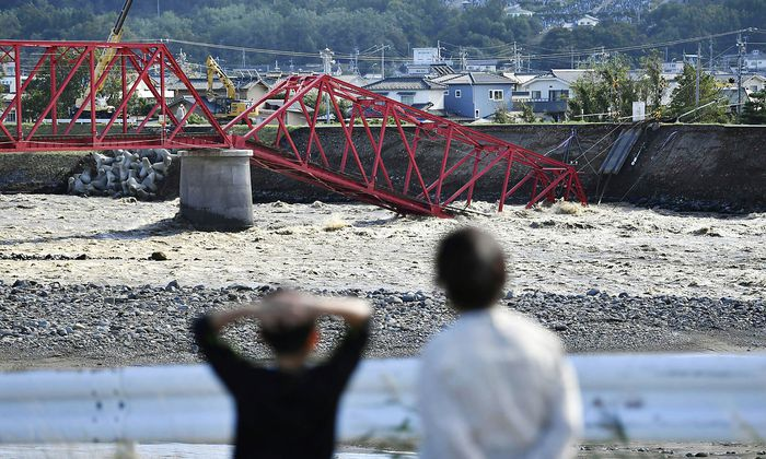 Powerful Typhoon in Japan Photo taken in Ueda, central Japan, on Oct. 13, 2019, shows a partially collapsed railroad br