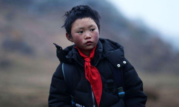 Wang Fuman hat Glück, denn nicht alle Kinder in China haben warme Kleidung.