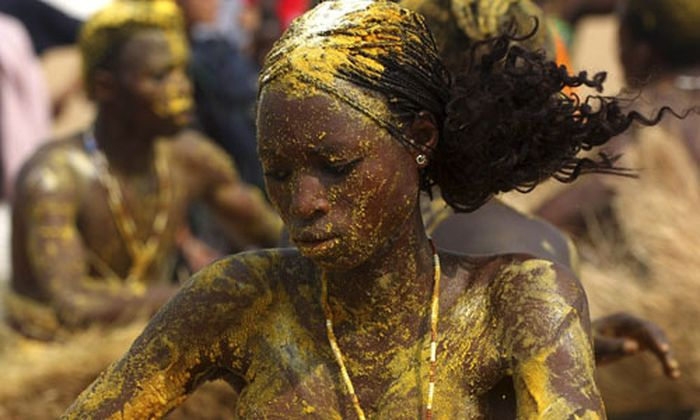 Voodoo worshippers dance at shore of Quidah beach during annual voodoo festival in Benin
