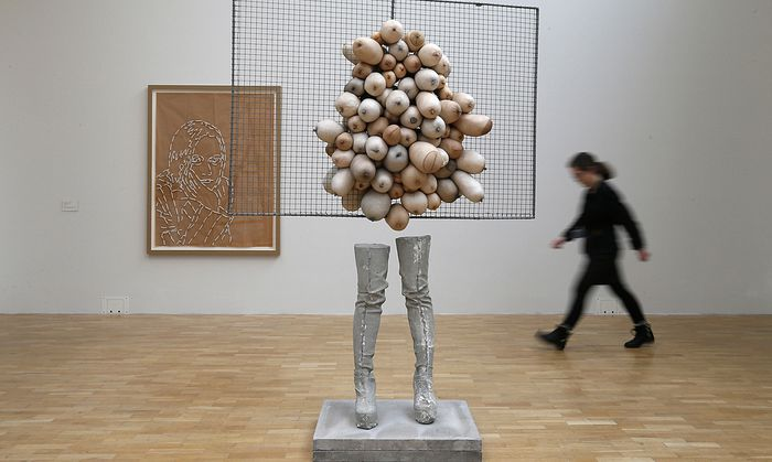 A worker walks past artwork ´Nice Tits´ by British artist Sarah Lucas in London