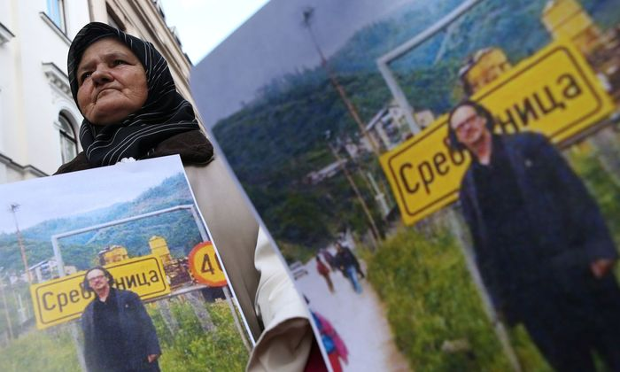 Representatives of the Association of Victims and Witnesses of Genocide hold a picture of the winner of the 2019 Nobel Prize for Literature Peter Handke in Srebrenica, during a protest in front of Sweden embassy in Sarajevo