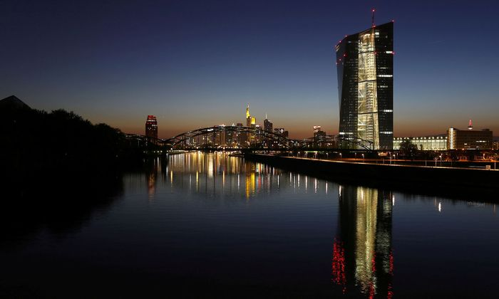 FILE PHOTO: The headquarters of the European Central Bank (ECB) (R) is seen next to the famous skyline in Frankfurt